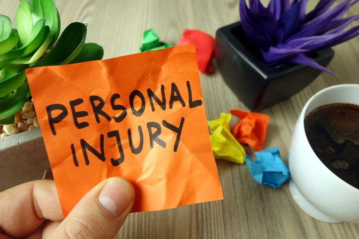 Personal injury handwritten text on sticky note, legal financial personal injury
