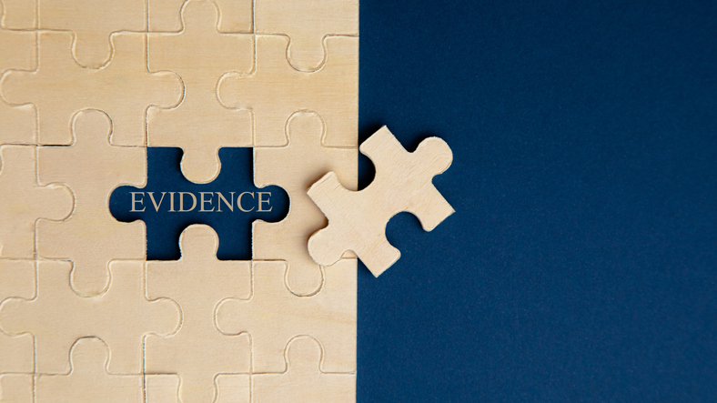 Puzzle on blue background, revealing the word evidence